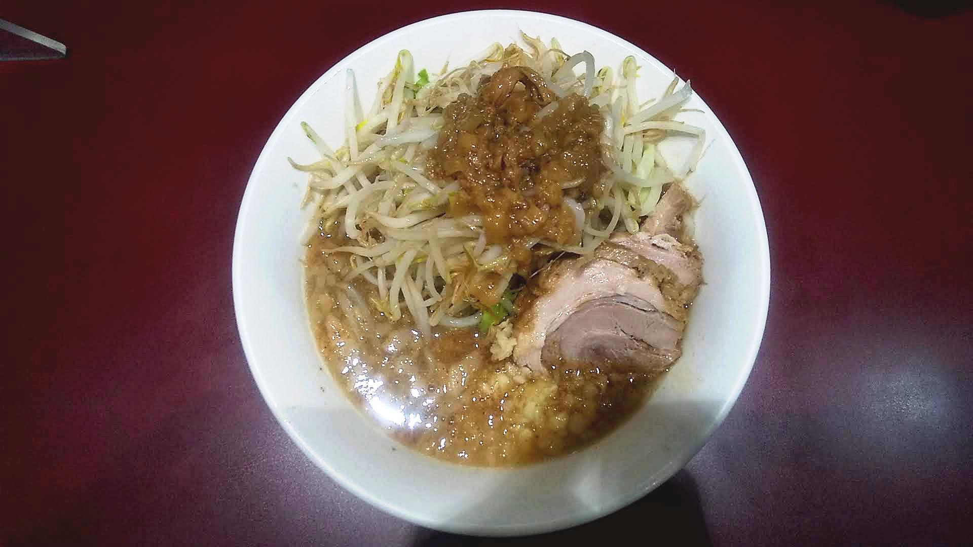 立川マシマシのつけ麺小のつけ汁の写真