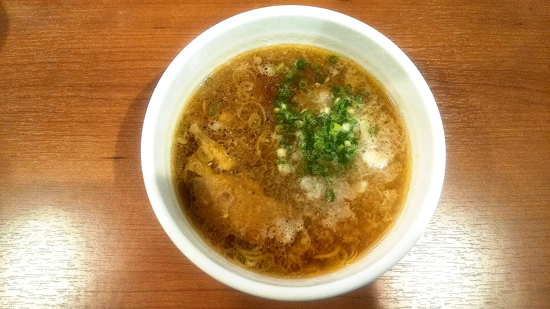 らーめんうち田のみぞれつけ麺のつけ汁の写真